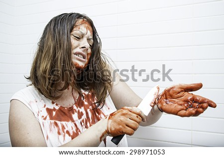 Woman with knife full of blood, violence