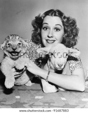 Woman with lamb and lion cub - stock photo