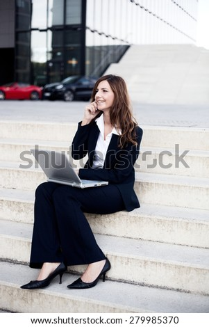 Woman with Laptop an Mobile Phone - stock photo