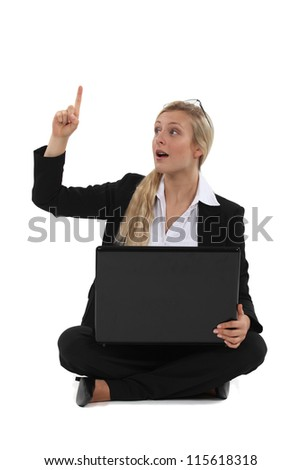 Woman with laptop having idea - stock photo