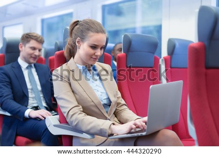Woman with laptop in a train