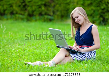Woman with laptop in the park