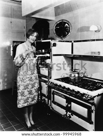 Woman with large stove - stock photo