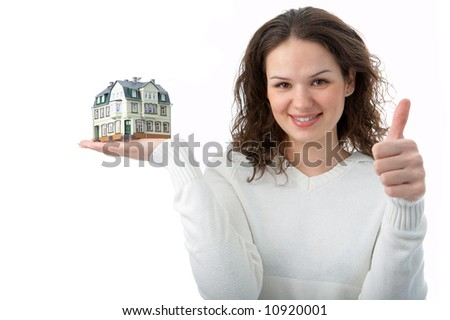 woman with little house on palm over white background