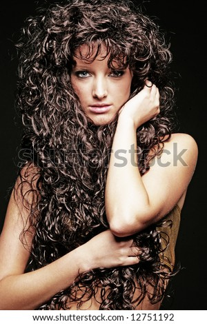 Woman with long dark curly hair - stock photo