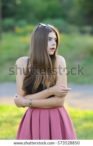Woman with long hair and beautiful eyes on a green background shows the different human emotions. Lady portrays surprised, scared