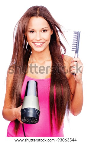 woman with long hair holding blow dryer and comb, isolated on white - stock photo