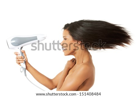 Woman with long hair holding strong blow dryer