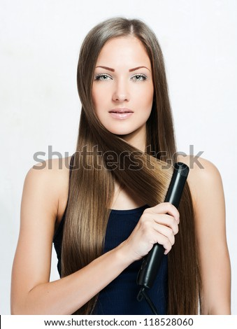 woman with long hair , makes styling hair - stock photo