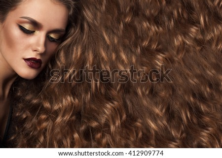Woman with long healthy hair and perfect make up