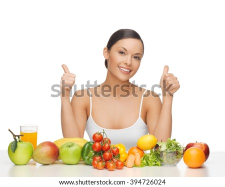 woman with lot of fruits and vegetables showing thumbs up - stock photo