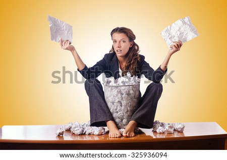 Woman with lots of discarded paper - stock photo