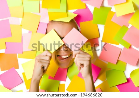 Woman with lots of reminders - stock photo