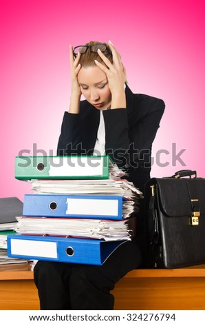 Woman with lots of work - stock photo