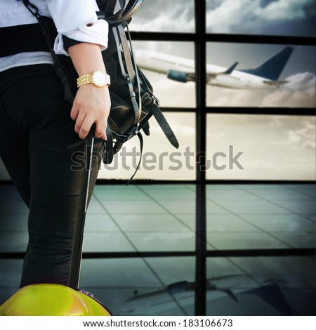 Woman with luggage in the airport