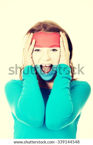 Woman with Luksemburg flag painted on face. - stock photo