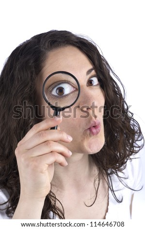 Woman with magnifying glass - stock photo