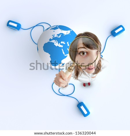 Woman with magnifying glass and the Earth with computer mouse - stock photo