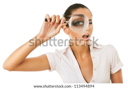 woman with magnifying glass on white background - stock photo