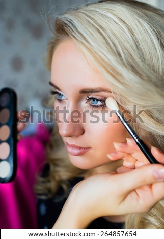 Woman with makeup brush. Stylist. make up brush - stock photo