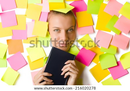 Woman with many reminder notes reading book