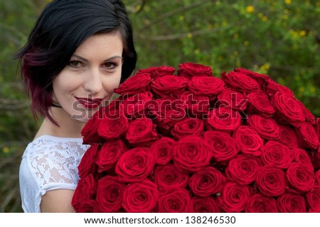 Woman with many roses