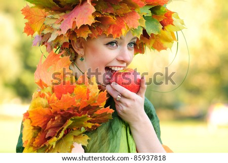 Woman with maple leaves outdoors. Close up face.