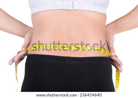 woman with measuring tape on white background - stock photo
