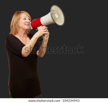 Woman with megaphone isolated on black background