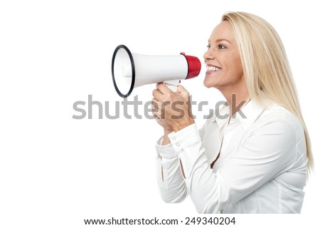Woman with megaphone making a public announcement - stock photo