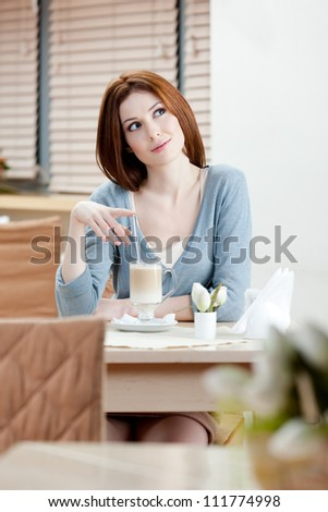 Woman with milk cocktail at the cafe - stock photo