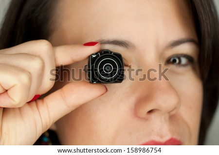 Woman with mini dslr photocamera - stock photo