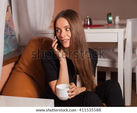 Woman with mobile phone and cup of coffee - stock photo