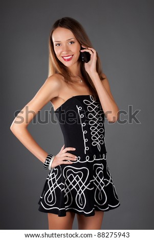 Woman with mobile phone studio photo - stock photo