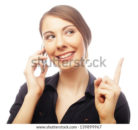 Woman with mobile smiling pointing up showing copy space. Closeup of beautiful young professional businesswoman isolated on white background.