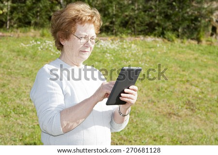 woman with mobile tablet outdoors - stock photo