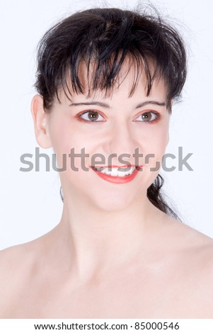 woman with modern curly hairstyle and brightly makeup /Beautiful face of a glamour makeup - stock photo