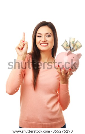 Woman with money box and banknotes in it isolated on white