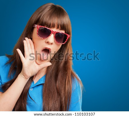 woman with mouth open isolated on blue background
