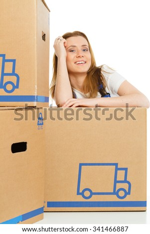 Woman with moving boxes are happy