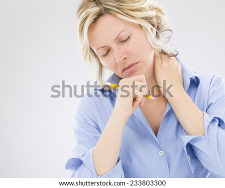 Woman with neck pain - stock photo