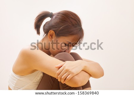 woman with negative expression or emotion, depression, sadness, unhappiness, problem, worry, suffering - stock photo