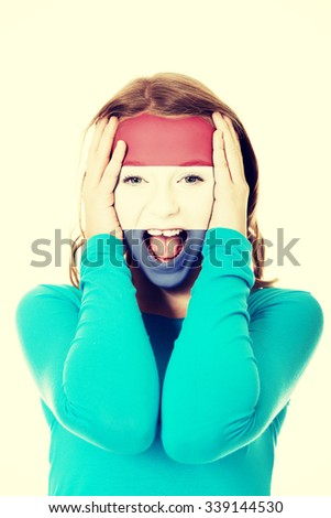 Woman with Netherlands flag painted on face. - stock photo