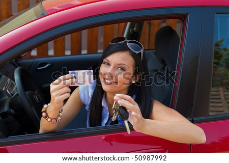 Woman with new car and driver\u0026#39;s license and car keys