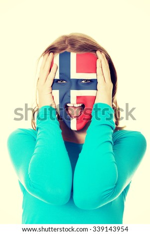 Woman with Norway flag painted on face. - stock photo