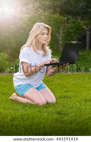 Woman with notebook on the grass
