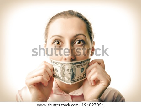 Woman with one hundred dollar bill at the mouth - stock photo