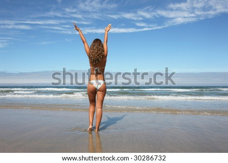 woman with open arms in the beach