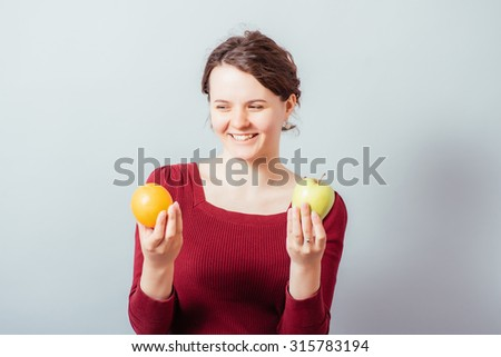 woman with oranges and apples