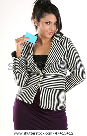 Woman with overcoat holding credit card - stock photo